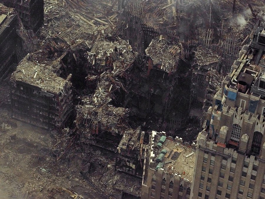 the-crater-and-surrounding-wreckage-at-the-site-of-the-world-trade-center-towers-after-the-terrorist-attacks-september-2001