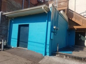 The mural location with a fresh coat of blue paint.