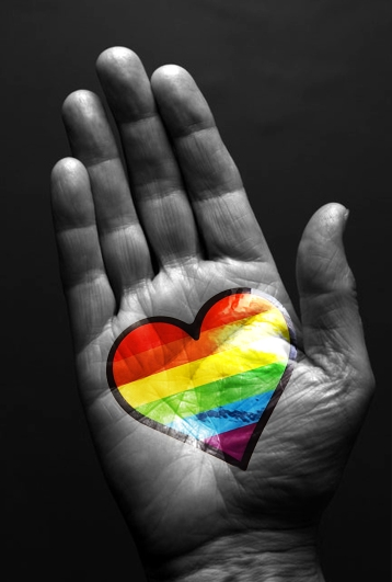 pride heart in hand