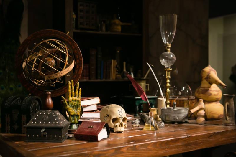 skull, hand, table